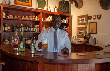 Barman Charles welcomes you to the Ingwezi Tavern!